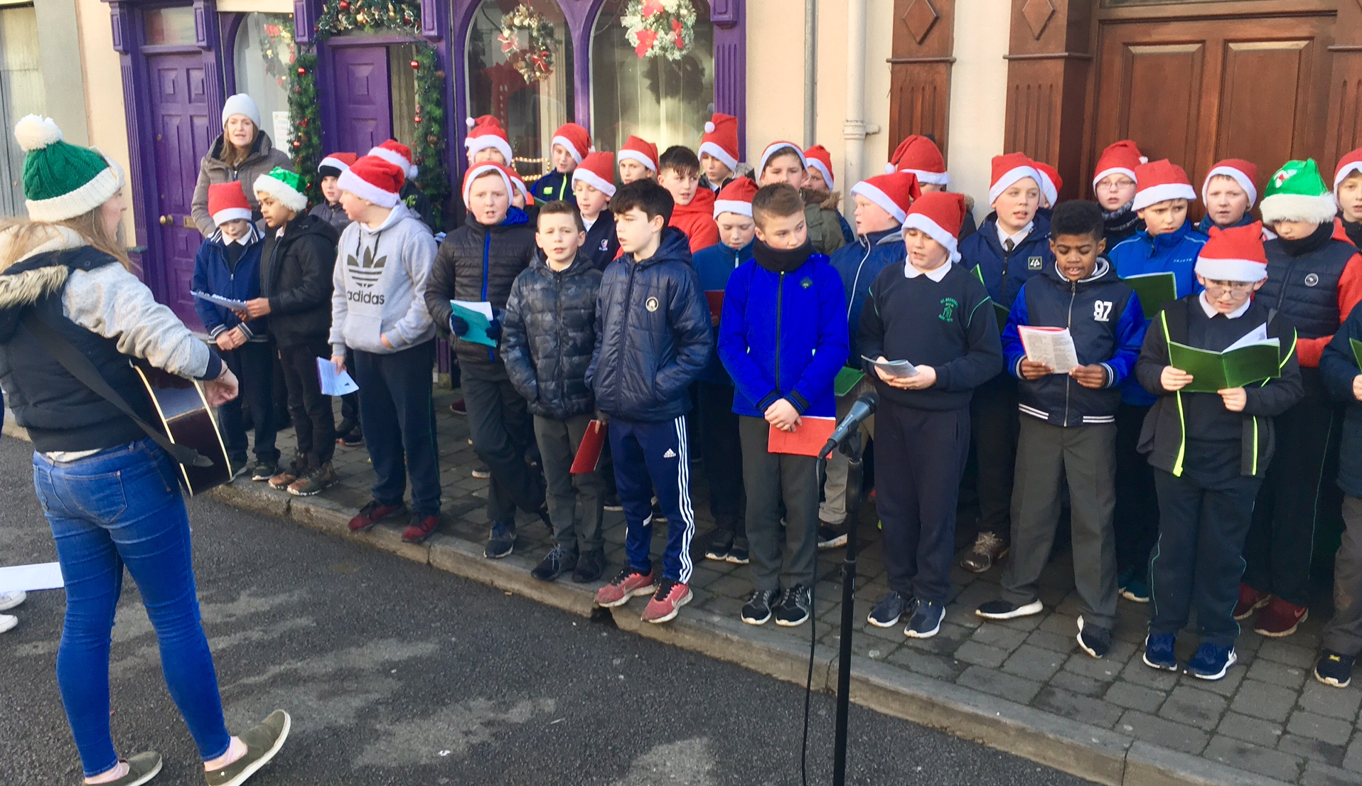 carol singing at lights